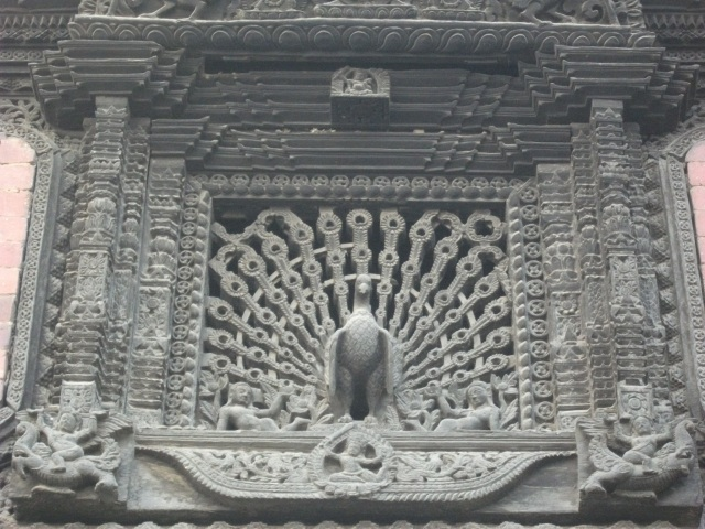 Kathmandu Durbar Square - decorative woodwork, a peacock window